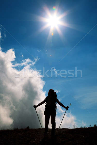 Stok fotoğraf: Siluetleri · mavi · gökyüzü · güneş · bulutlar · spor