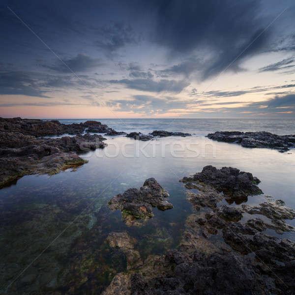 Stock fotó: Tenger · part · naplemente · tengeri · kilátás · kék · ég · felhők