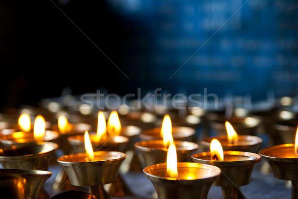 Yanan mumlar siyah mavi yangın kilise Stok fotoğraf © All32