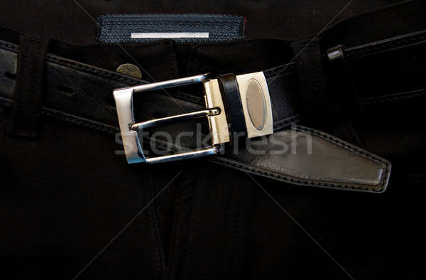 Unfastened a strap on black jeans  Stock photo © All32