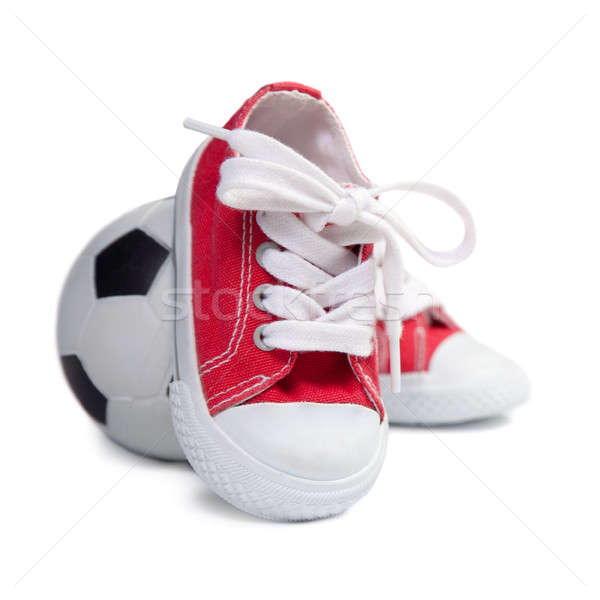 Children's sneakers and soccer ball Stock photo © All32