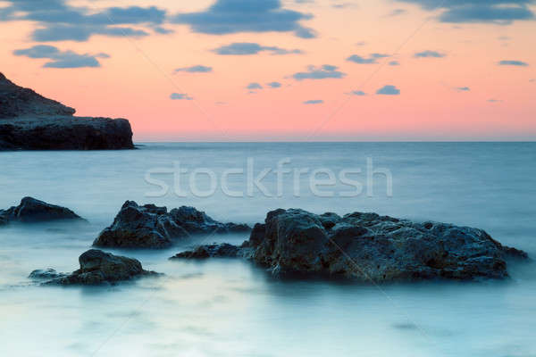Seashore with misty water at sunset Stock photo © All32