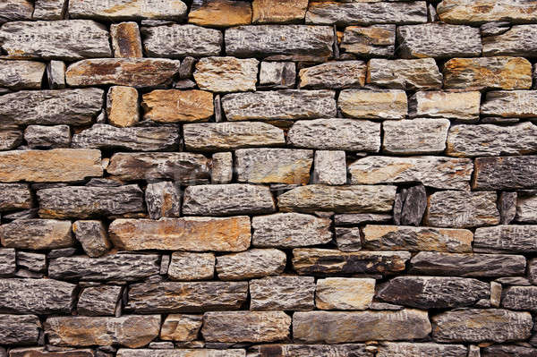 Wall built of natural stone. Stock photo © All32