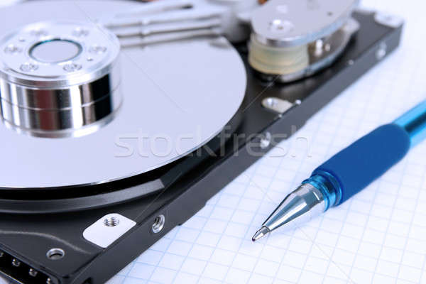 Hard disk and pen Stock photo © All32