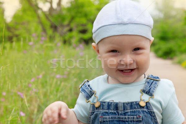 Portret gelukkig weinig jongen cap jeans Stockfoto © All32