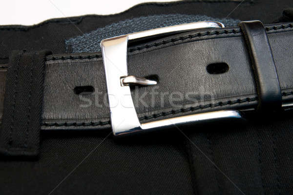 Buttoned strap on black jeans  Stock photo © All32