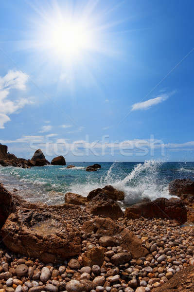 Strand rotsen zee zon blauwe hemel zonsondergang Stockfoto © All32