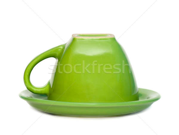 Green inverted cup on a saucer. Isolated on white background. Stock photo © All32