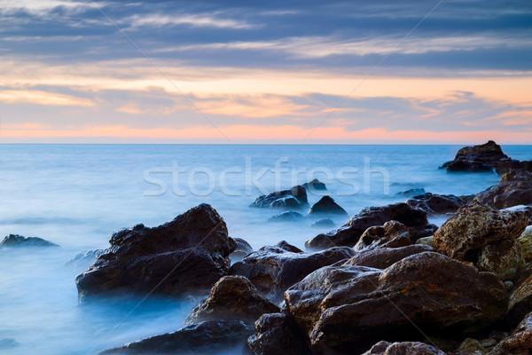 Tengeri kilátás ködös víz naplemente természet háttér Stock fotó © All32