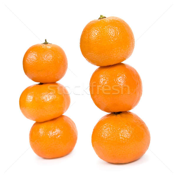Pyramid of mandarins. Isolated on white background. Stock photo © All32