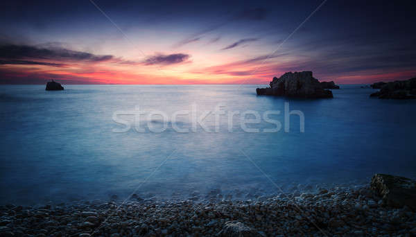 Sea coast under blue sky with clouds at sunset  Stock photo © All32