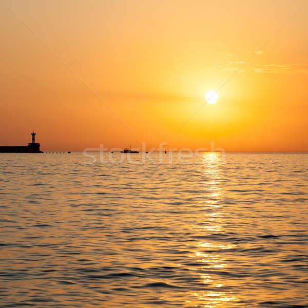 Barco navegação mar pequeno pôr do sol céu Foto stock © All32