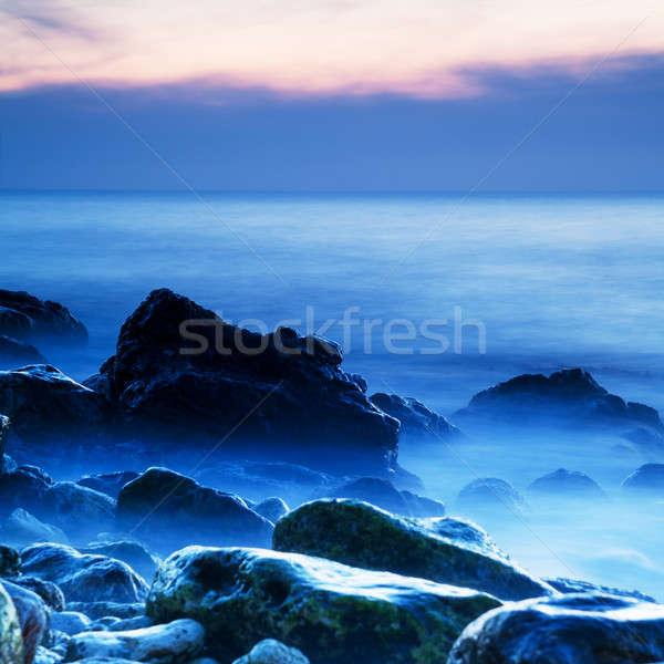 Marinha nebuloso água pôr do sol natureza fundo Foto stock © All32