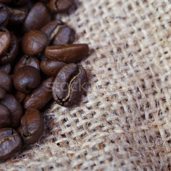 Coffee grains scattered on sacking Stock photo © All32