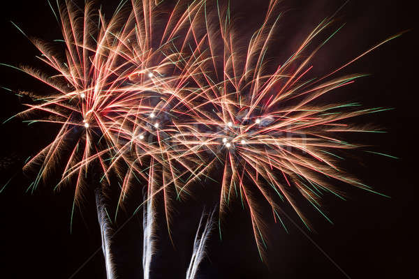 Fireworks in the night sky over water Stock photo © All32