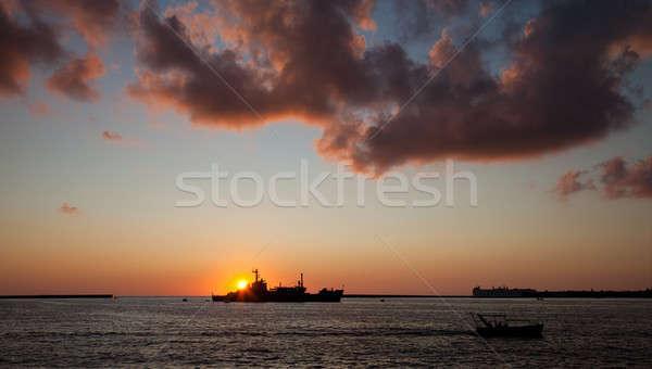 Gemi deniz gün batımı bulutlar güneş Stok fotoğraf © All32