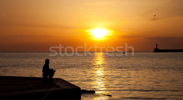 Silhouettes of Fishermen at sunset Stock photo © All32