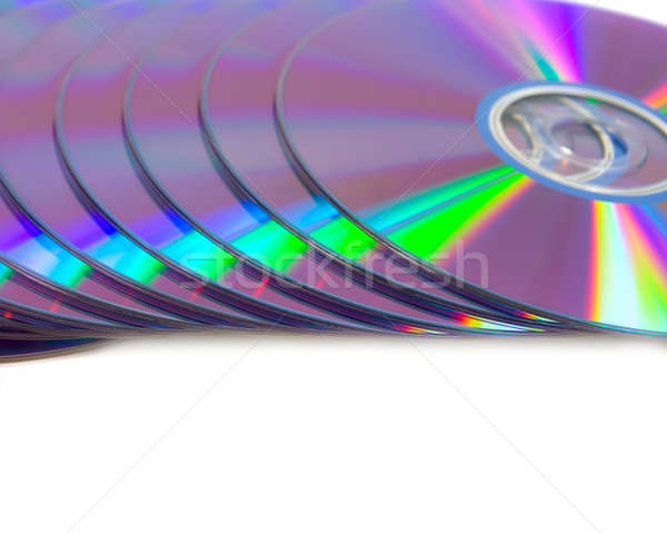 Play of light on the CD disks. Isolated on white background. Stock photo © All32