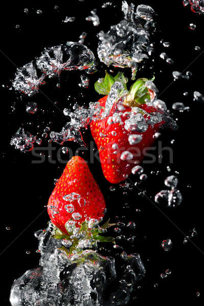 Two strawberries in the water with air bubbles  Stock photo © All32