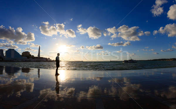 Silhouette of a boy on the seafront Stock photo © All32