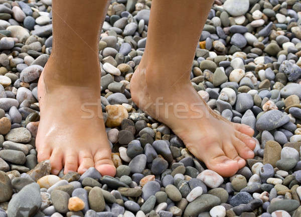 Childish legs on pebble Stock photo © All32