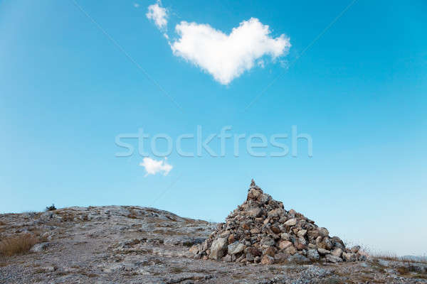 A pile of stones and a passing cloud in the shape of heart Stock photo © All32