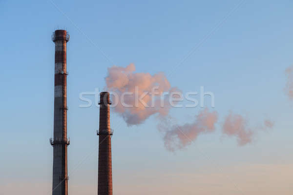 Industrial high chimneys producing smoke Stock photo © All32