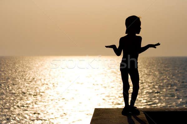 Silhouette garçon danse coucher du soleil mains été Photo stock © All32