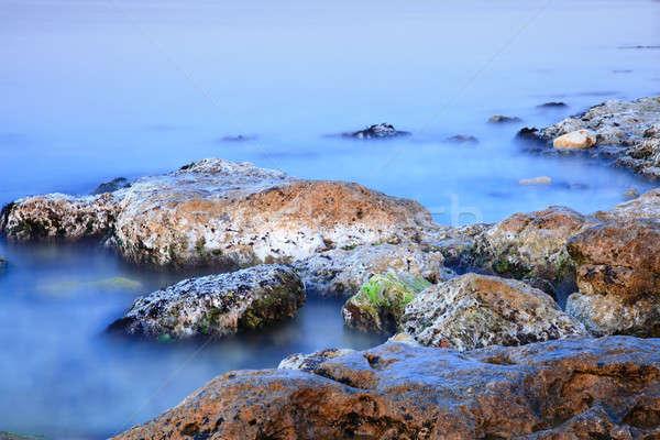 Kustlijn kleurrijk stenen mistig water natuur Stockfoto © All32