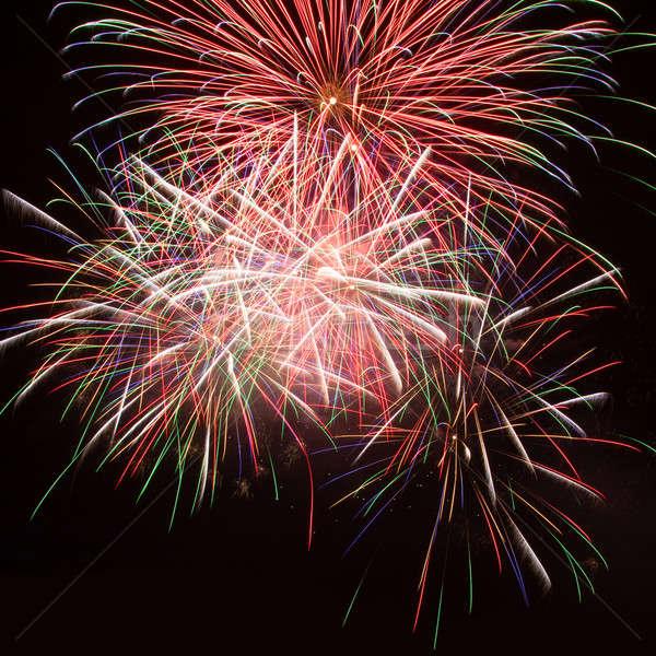 Fogos de artifício céu noturno colorido vermelho céu festa Foto stock © All32
