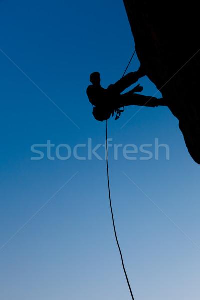 Kaya mavi gökyüzü adam spor gün batımı enerji Stok fotoğraf © All32