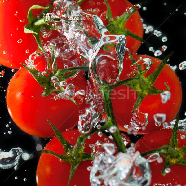 Tomatoes in the water with air bubbles Stock photo © All32