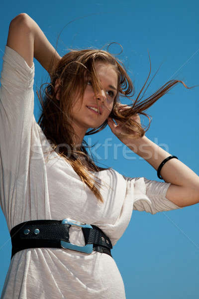 Girl with hair fluttering in the wind Stock photo © All32