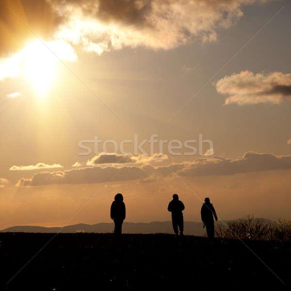 Emberek menny sziluettek négy személy égbolt felhők Stock fotó © All32