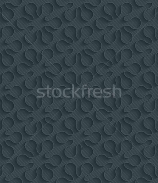 Stock photo: Dark perforated paper.