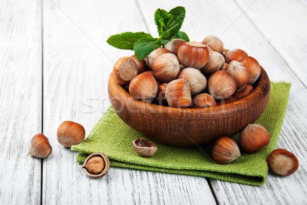 Bowl with hazelnuts Stock photo © almaje