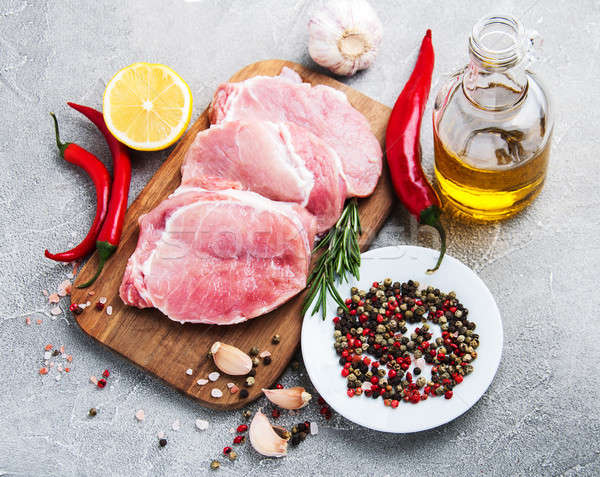 Fresh raw pork chops with spices and herbs Stock photo © almaje