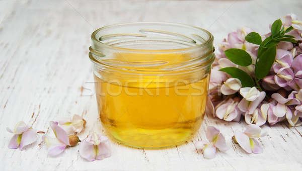 Stock photo: honey with acacia blossoms