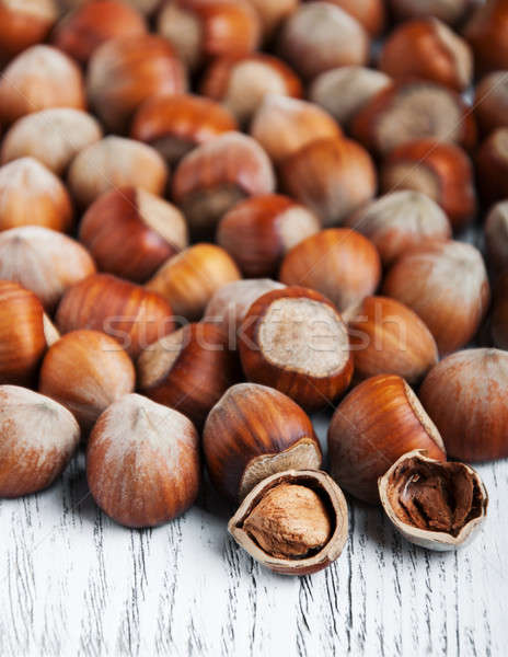 hazelnuts on a wooden table Stock photo © almaje