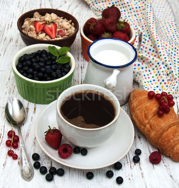 Fresh berries, coffee and croissant Stock photo © almaje