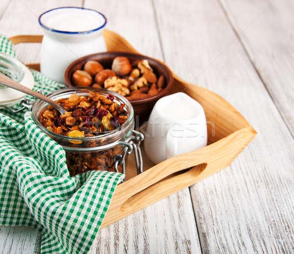 Házi készítésű granola diók tej fa asztal gyümölcs Stock fotó © almaje