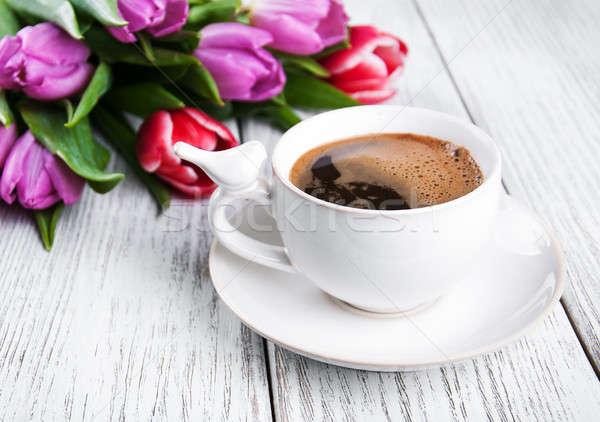 Csésze kávé tulipánok öreg fa asztal virág Stock fotó © almaje