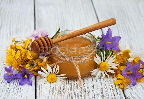 Jar honing oude houten tafel bloem Stockfoto © almaje