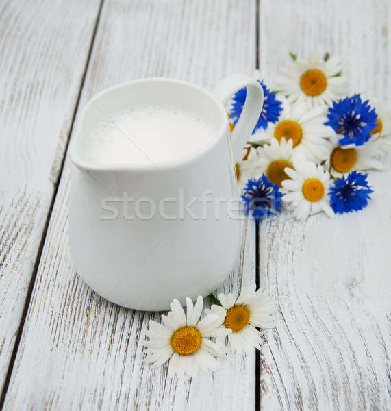 jug with milk  and wildflower Stock photo © almaje