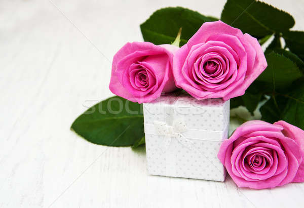 Pink  roses and gift box Stock photo © almaje