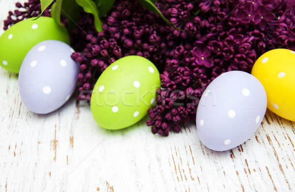 Húsvéti tojások friss orgona virágok öreg fából készült Stock fotó © almaje