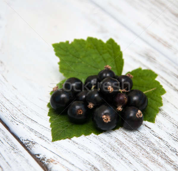 Stock photo: Blackcurrant on the wooden table