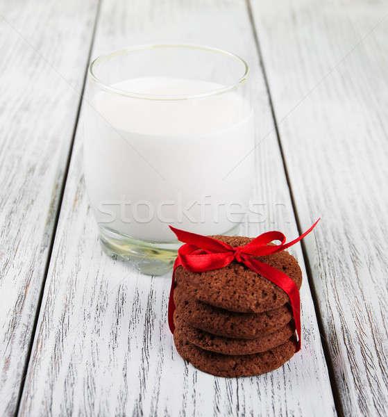Kása sütik üveg tej öreg fa asztal Stock fotó © almaje