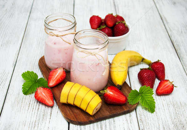 yogurt with fresh strawberries and banana Stock photo © almaje