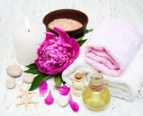 Peony flowers, massage oils and salt Stock photo © almaje